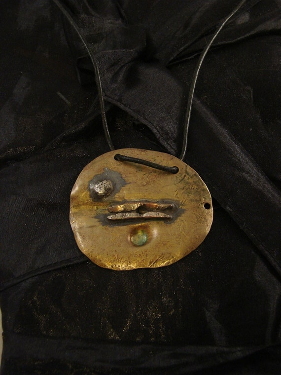 The Rising Sun art pendant in solid bronze silver