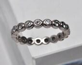 bezel set diamond eternity ring - 18k palladium white gold