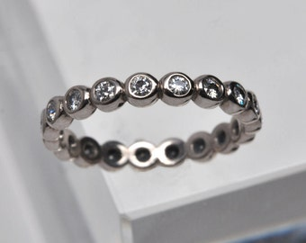 bezel set diamond eternity ring - 18k palladium white gold