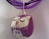 SS purple sleepy porcelain owl on a 18 inch purple ribbon necklace cord