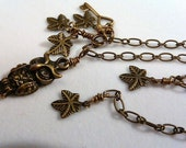 CLOSEOUT Adjustable hand wired antique brass finish necklace with owl, key and leaves