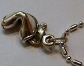 Sterling Silver Fortune Cookie pendant on a S/P chain