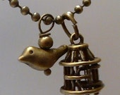 Antique Bronze Bird with Cage on a 24 inch 2.5mm Ball Chain