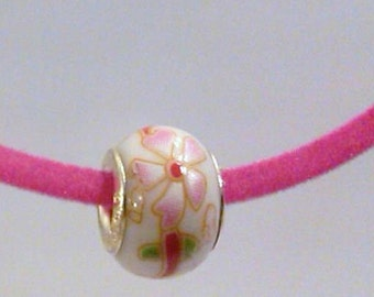 CLOSEOUT White with pink flowers glass bead on a pink velvet necklace cord