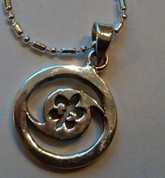 Sterling Silver Hurricane Fleur De Lis pendant charm on a 16 1/2 inch sp chain