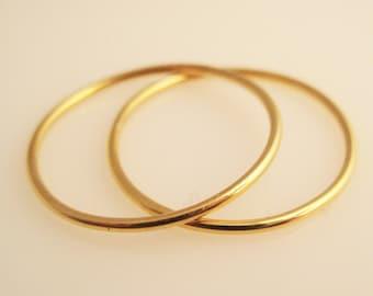 Duet, a Pair of 22K Gold Sols