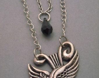 Sparrow                                            A silver necklace