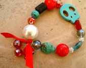 Red calavera-A colorful  red, turquoise and black bracelet with a howlite skull bead