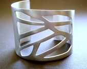 Large silver cuff with geometric pattern