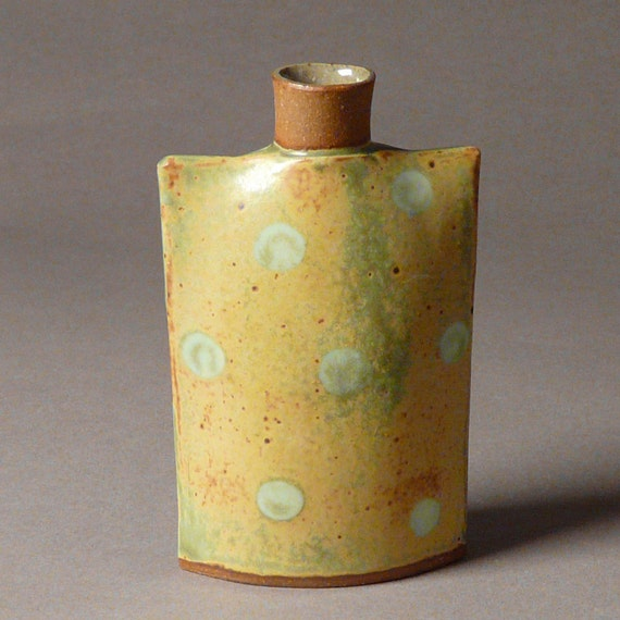 Stoneware oval flask bottle vase in shino embedded dots