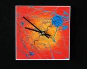 Vibrant, orange and blue, abstract art clock