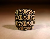 Olive and Black Glass Focal Bead with Waves and Dots - Moretti
