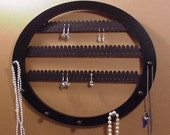 Earring rack and Necklace holder, display holds about 70 earring pairs, 7 PEGS  Wall mounted OVAL