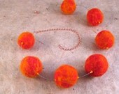 Seven suns felted necklace