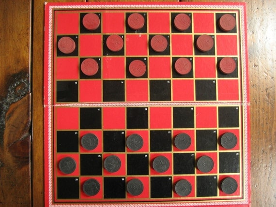 Checkers game pieces vintage wooden