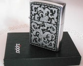 ZIPPO STORMING SILVER LIGHTER - BOXED AND NEVER USED - VINTAGE