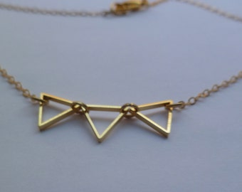 Tiny bunting necklace, three mini outline triangles in golden on thin gold fill chain