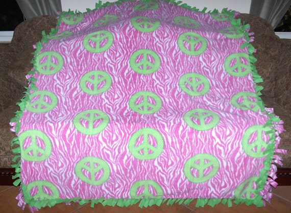 Fleece Tie Blanket Hot pink and white Zebra stripes w/ lime green peace signs lime green back 60x72