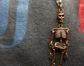 tiny articulated skeleton pendant