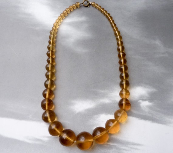 BLOW OUT SALE --- Vintage Graduated Amber Glass Bead Necklace
