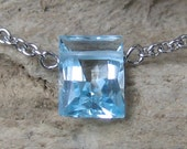 Bella Necklace in Blue Topaz Emerald-Cut