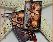 Flower Power  - Earrings have copper flowers and red Swarovski crystal.