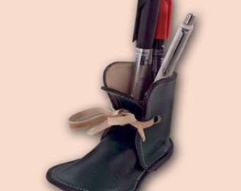 Small green shoe pencil holder