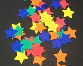 Star Die Cuts.... Paper confetti.... primary colors... paper punches.... sprinkles.... embellishments...