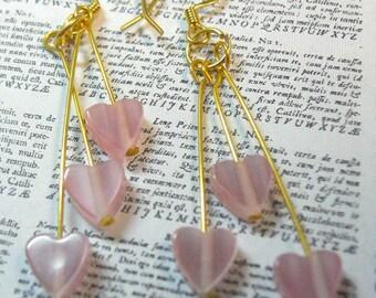 Pink hearts triple dangle earrings in cats eye