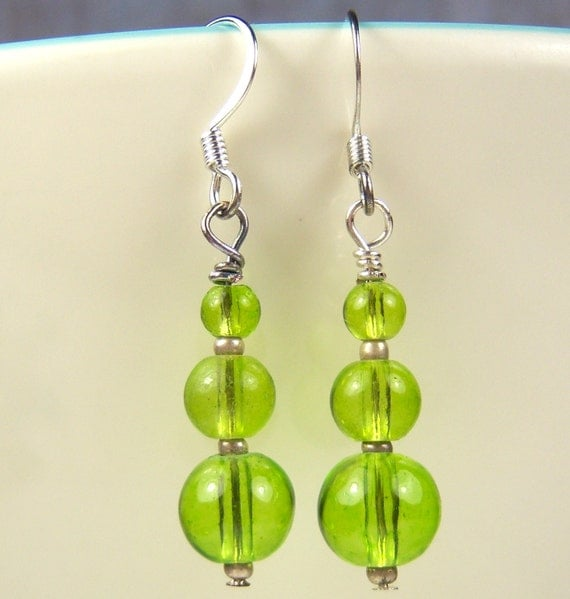 Green glass beads in a drop dangle earring