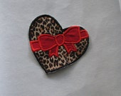 Leopard print heart with bow applique