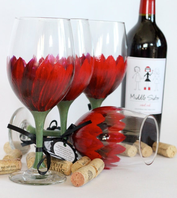 Set of 4 Blood Red wine goblets that are hand painted and top rack dishwasher safe.