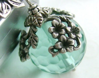 """Delicate sterling chain necklace """"The World in Bloom"""" charm necklace,  aqua ball and silver flowers, light blue glass, floral draping"""