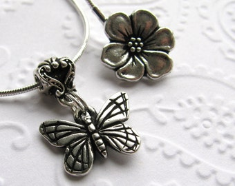 Butterfly charm necklace with flower clasp - Tierra Cast silver pewter charm, bail and clasp, winged garden insect