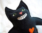 Just in time for Halloween a black upcycled sweater cat
