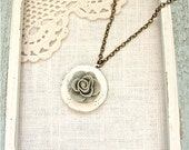 Cream rose locket necklace.  Long style antique brass chain.  Jewelry by Sweet And Simple.