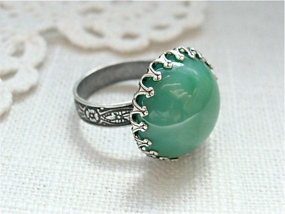Vintage Swarovski jade green glass ring.  Antique silver.