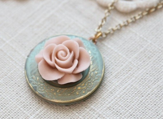 Weathered vintage style locket necklace.  Antique blue with a pale pink blooming rose.