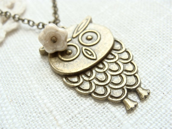 Antique brass owl necklace with cream flower bead.