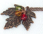 Antiqued Copper Maple Leaf Necklace With Topaz, Olive Green And Red Swarovski Crystals