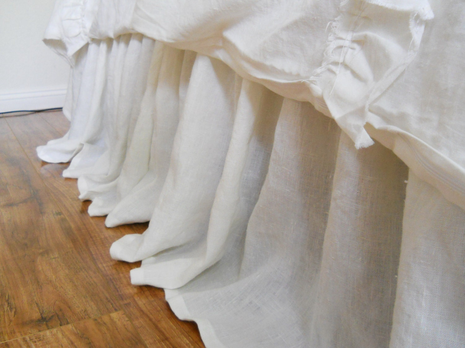 The Annabelle Bed Skirt is a classic dust ruffle that features a gathered, lace design. % Linen Voile Drop Lined Machine wash delicate; tumble dry.
