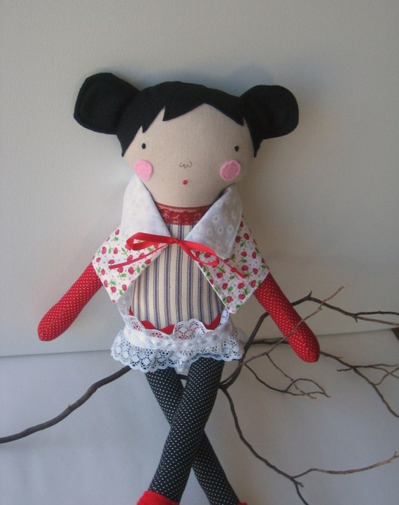 Cloth doll with black hair and scarf/shawl