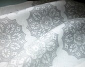 Lace Medallion snowflake geometric hand block printed in pearl gray on white linen fabric by the yard