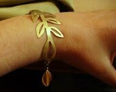 satin brass branch bracelet with charm in gold