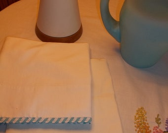 Set of turquoise braided rickrack trimed pillowcases