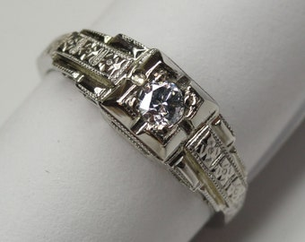 A Vintage 18K White Gold Engagement Ring, Hand-Engraved and set with a Diamond. (A1364)
