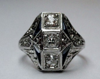 A Fantastic Art Deco Ring made in 18k White Gold with Diamonds and Sapphires. (A1292)