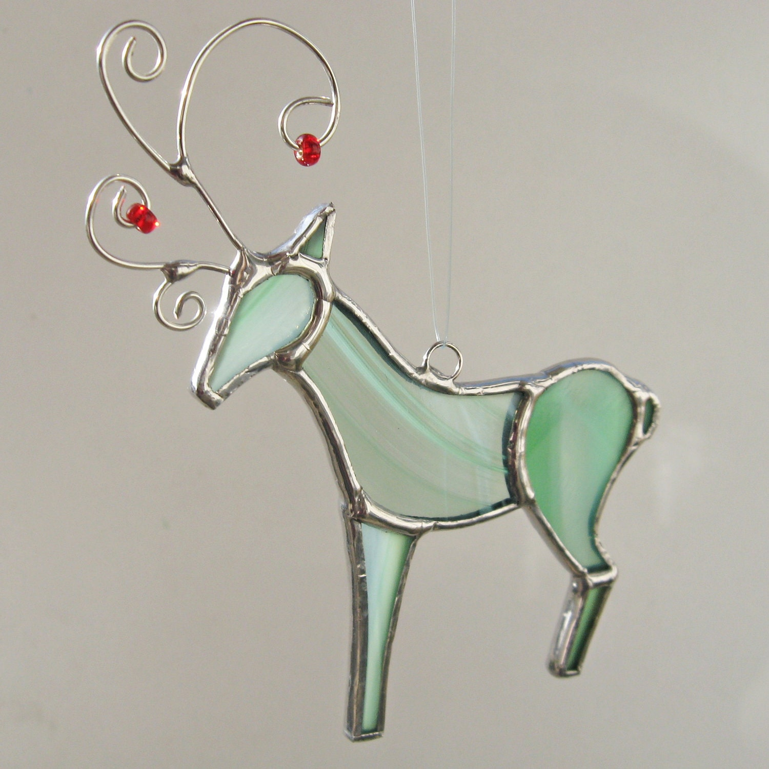 Mint green stained glass reindeer ornament by fivesparrows on etsy