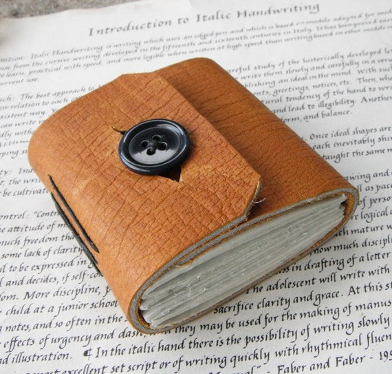 Honey Button Journal - thick brown leather with a black button closure.