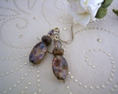 handmade mottled brown Picasso bead earrings with brass